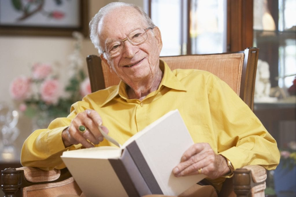 A senior independent living and reading a book