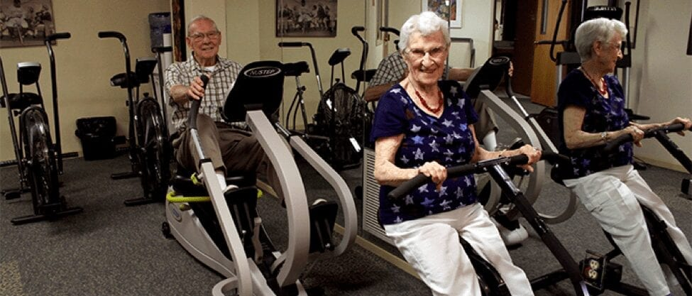 Terrace Retirement Community residents exercise on the workout equipment available in the Terrace on-site gym.